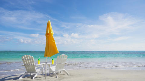 Idea for advertising a beach resort. Beach accessories and clear Caribbean sea beach Live Action