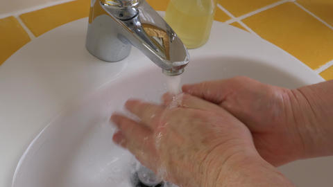 Man washes his hands with soap Live Action