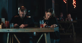Couple in bar using mobile phone 4k video. Digital addiction Footage