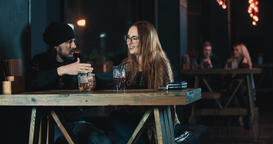Couple in date talking at bar 4k video. Woman man laughing Footage