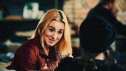 Beautiful woman talking with man bar HD slow motion video. Blonde girl flirts Footage
