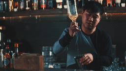 Bartender pouring alcohol shaker at bar counter HD slow motion video. Cocktail Footage