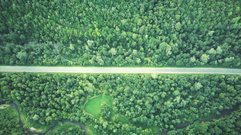 Aerial drone footage of road in mountains. Aerial video Live Action
