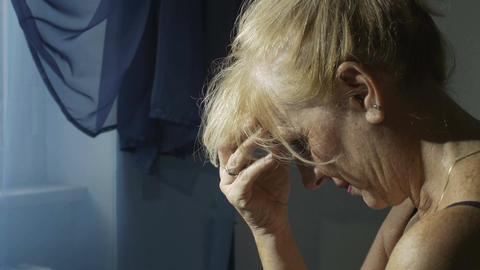 desperate woman near the window: depression, divorce, couple crisis Footage