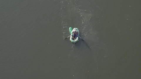 Man catches fish on boat view from a bird's-eye view Live Action