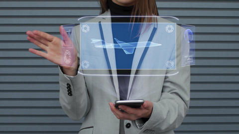 Business woman interacts hologram business jet Live Action