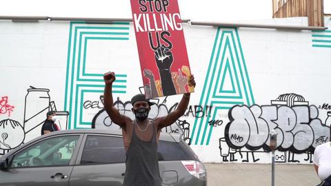 Black Male With Mask and Stop Killing Us Sign, LA Black Lives Matter Protest Live Action