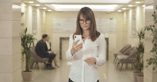 Middle shot of young businesswoman in eyeglasses having vision problems Live Action