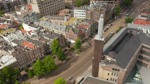 Amsterdam Street with Public Transport Tram from Aerial Drone Perspective Live Action