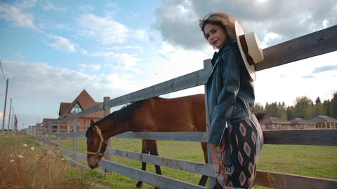 Stylish lady standing near horse Live Action