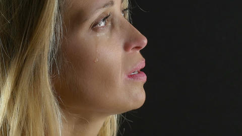 sad woman deep in prayer is crying: good, loneliness, seeking help Footage