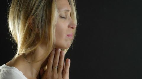 young cute girl deep in prayer: praying, woman, intense, intensely Footage