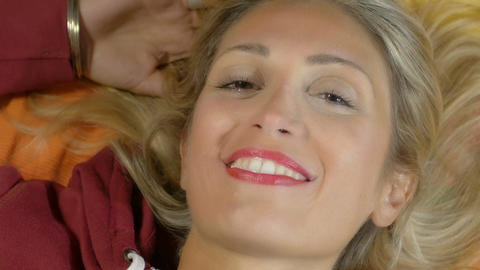 beautiful blonde girl smiling to the camera: carefree, smile, young, relaxed Footage