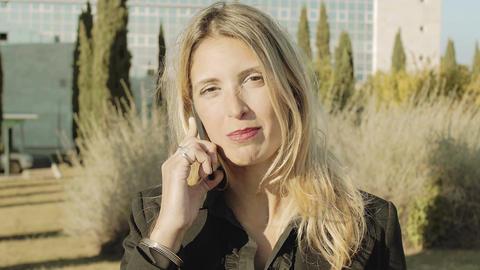 happy businesswoman using smartphone: beautiful woman in career talking Footage
