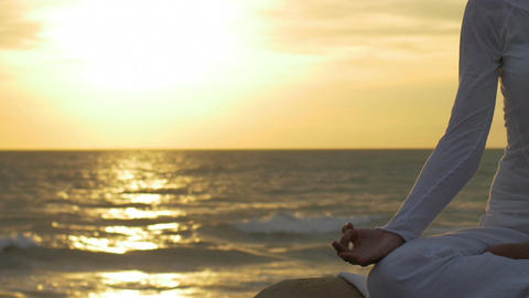 particular on hand of a woman in meditation on the beach: yoga position Footage