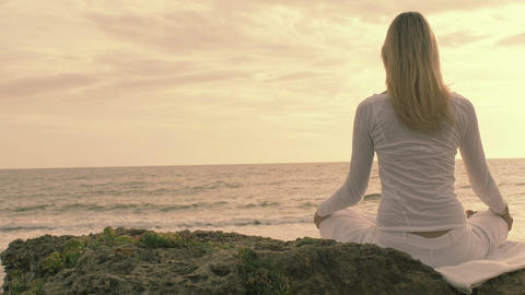 practice of yoga on the beach: woman having meditation moments, spiritual time Footage