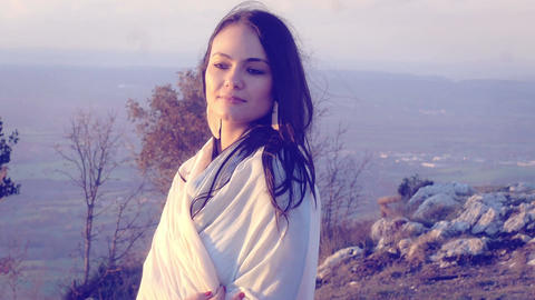 relaxing young woman on the top of a mountain: relaxed, peaceful, cheerful Live Action