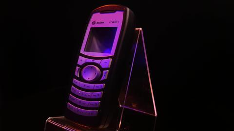 Vintage Sagem MyX2-2 Lightweight Mobile Cellphone, Spinning Close Up Full Frame Live Action