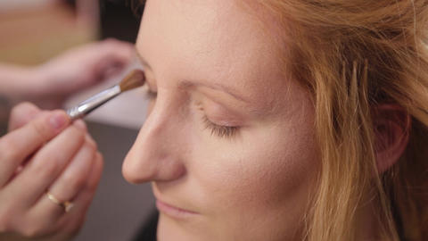 Beautiful woman doing makeup in a beauty salon Live Action