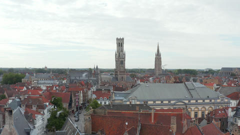 Belfry of Bruges Belltower from an Aerial Drone perspective and Pigeon Birds Live Action