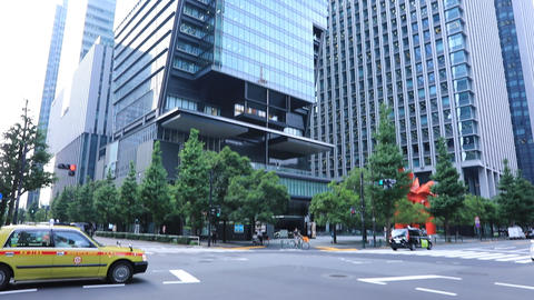An urban building at the business town in Tokyo wide shot tilt Live Action