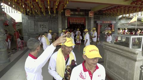 Staff carry the deity statue out the chinese traditional temple for celebration Live Action