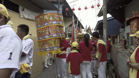 Public prepare to carry the statue of deity for procession in the afternoon Live Action