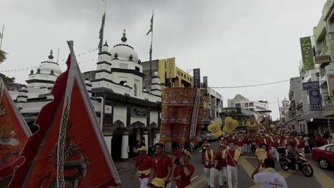 Chinese deity procession pass in front of mosque Live Action