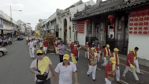Traditional chinese deity parade in front of Temple Han Cheang Live Action