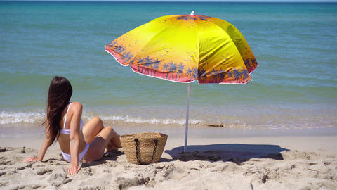 Young woman in hat on the beach vacation Live Action