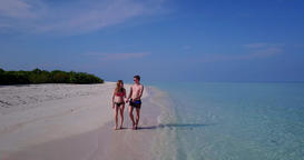 Man and lady sunbathe on tranquil resort beach time by turquoise ocean and white sand background of Live Action
