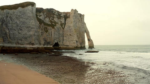 Sea stack by the coast line cause by erosion Live Action