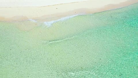 Summer beach and soft wave background. Sand and sea. Tropical summer vacation Live Action