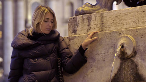sad woman in Rome near a fountain in St. Peter square: sadness, depression Live Action