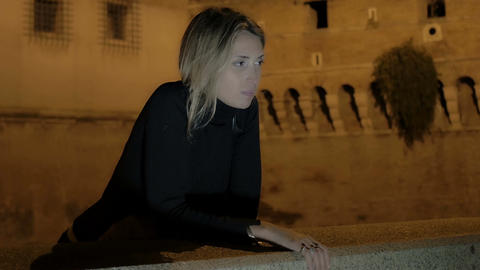 depressed young woman waiting for something in the evening in Rome city center Footage