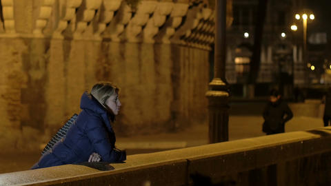 young sad and beautiful woman in the evening in Rome: thoughtful, pensive Footage