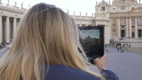 young cute woman making photos with tablet to St. Peter Church in Rome Footage