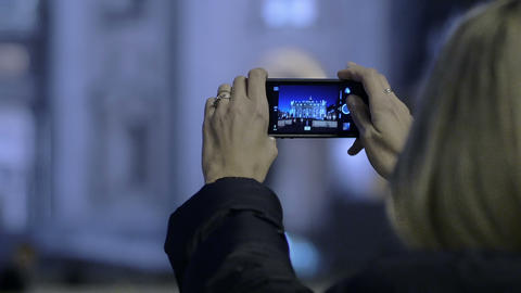 young tourist makes night's photos to St. Peter Church in Rome with smart phone Footage