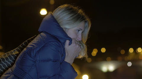 thoughtful woman in the street of the city center during the night: pensive sad Footage