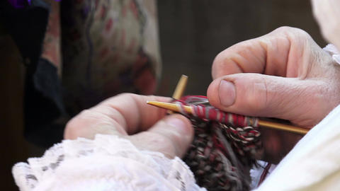 detail of hands and knitting needles Footage