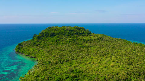 Tropical island covered in the jungle, top view. Himokilan Island, Leyte Island Live Action