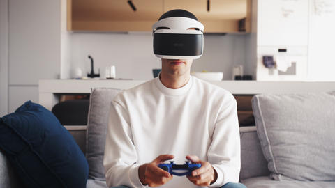Slow motion scene video of caucasian man using VR device to play video games Live Action