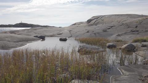 Typical coastal landscape with smooth rock shoreline. Bohuslan, Sweden Live Action