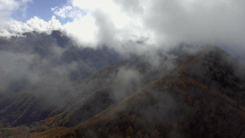 Fly through cloudy sky at Minami Alps Footage