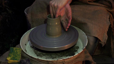 Experienced master doing a clay vase on a pottery wheel Live Action