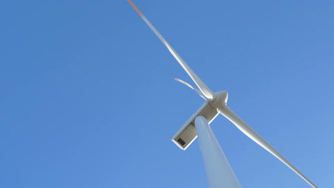 wind turbine against blue sky Footage