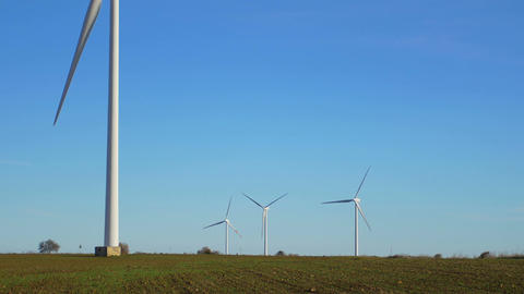 wind turbine against blue sky: green energy, RENEWABLE energy, efficiency Live Action
