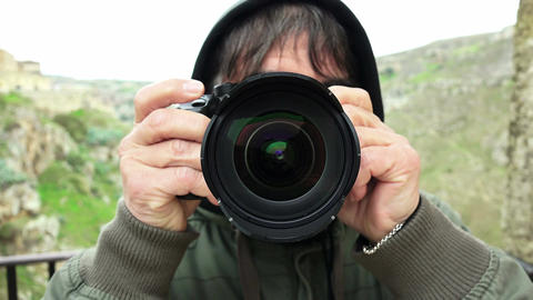 man taking pictures with professional reflex camera Footage