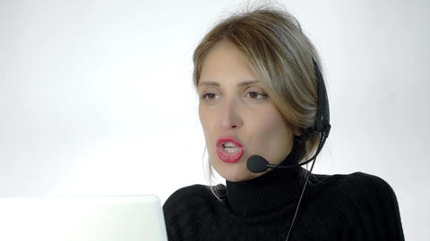 call center: woman working with headphones and computer Footage