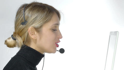 customer service: woman at work with headset and personal computer Footage